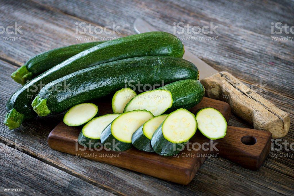 Fresh zucchini on wooden background stock photo