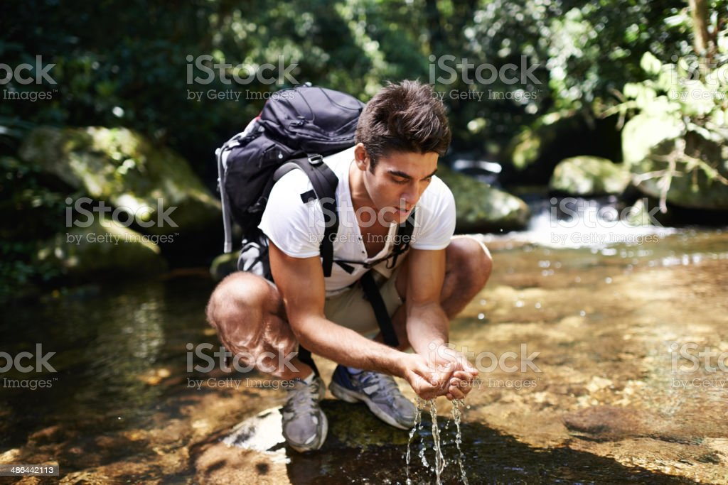 Freshening up after a long hike stock photo