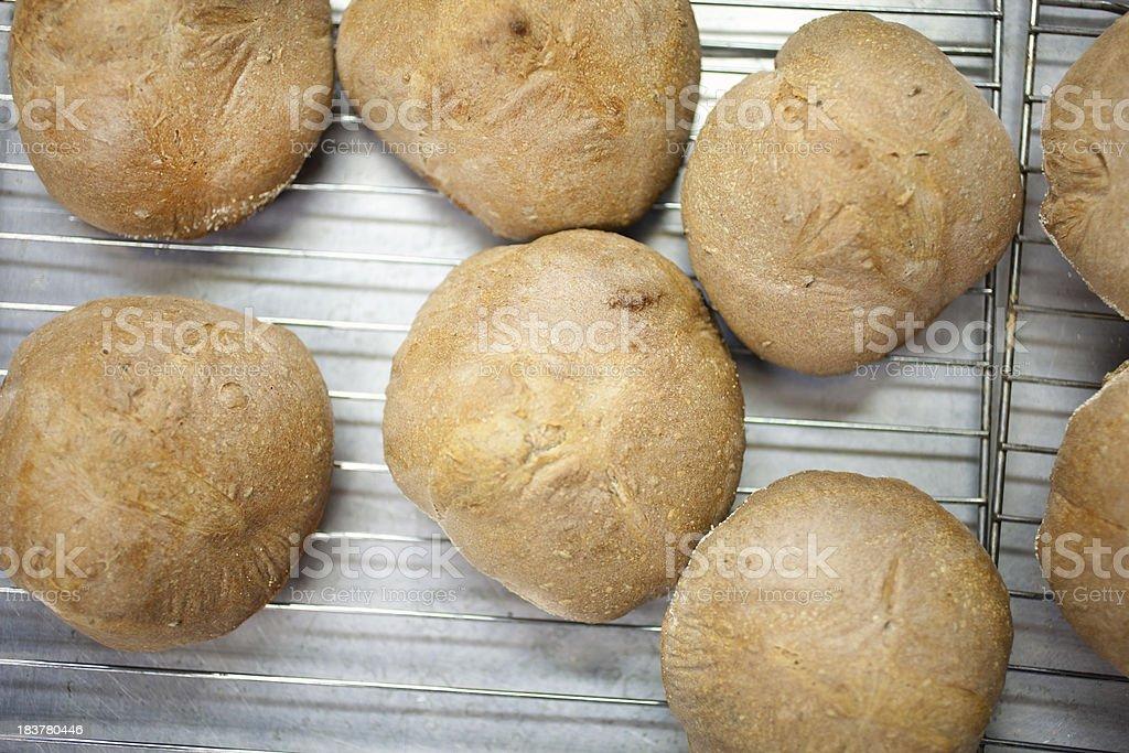 Freshly baked artisan bread rolls stock photo