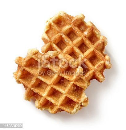 freshly baked belgian waffles isolated on white background, top view