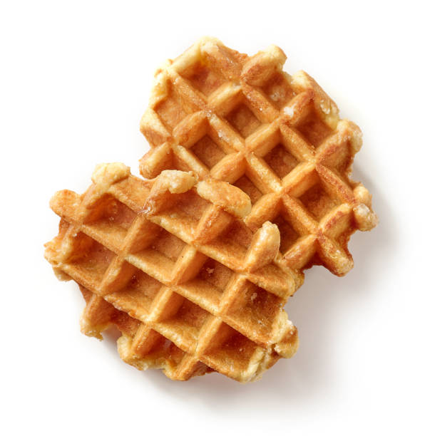 freshly baked belgian waffles freshly baked belgian waffles isolated on white background, top view waffle stock pictures, royalty-free photos & images
