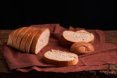 freshly baked bread on dark wooden kitchen table. Selective focus
