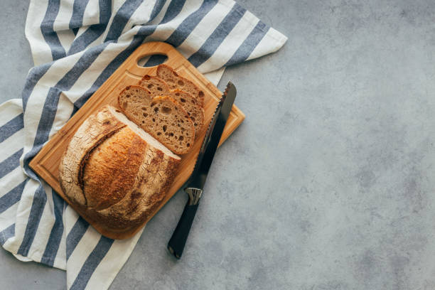 Freshly Baked Bread on Wooden Table Freshly Baked Bread on Wooden Table table top view stock pictures, royalty-free photos & images