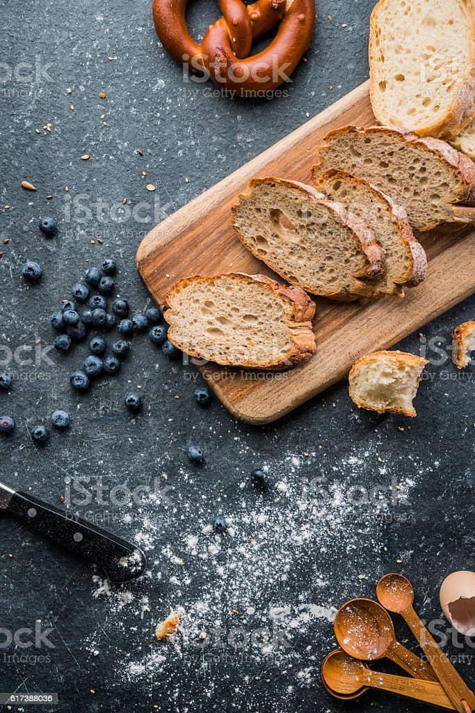 Freshly baked bread on wooden table stock photo