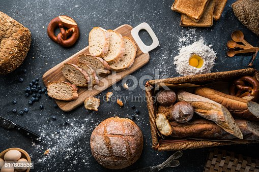 istock Freshly baked bread on wooden table 617603536