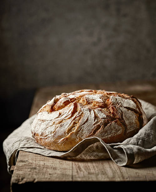 freshly baked bread freshly baked bread on rustic wooden table bread stock pictures, royalty-free photos & images