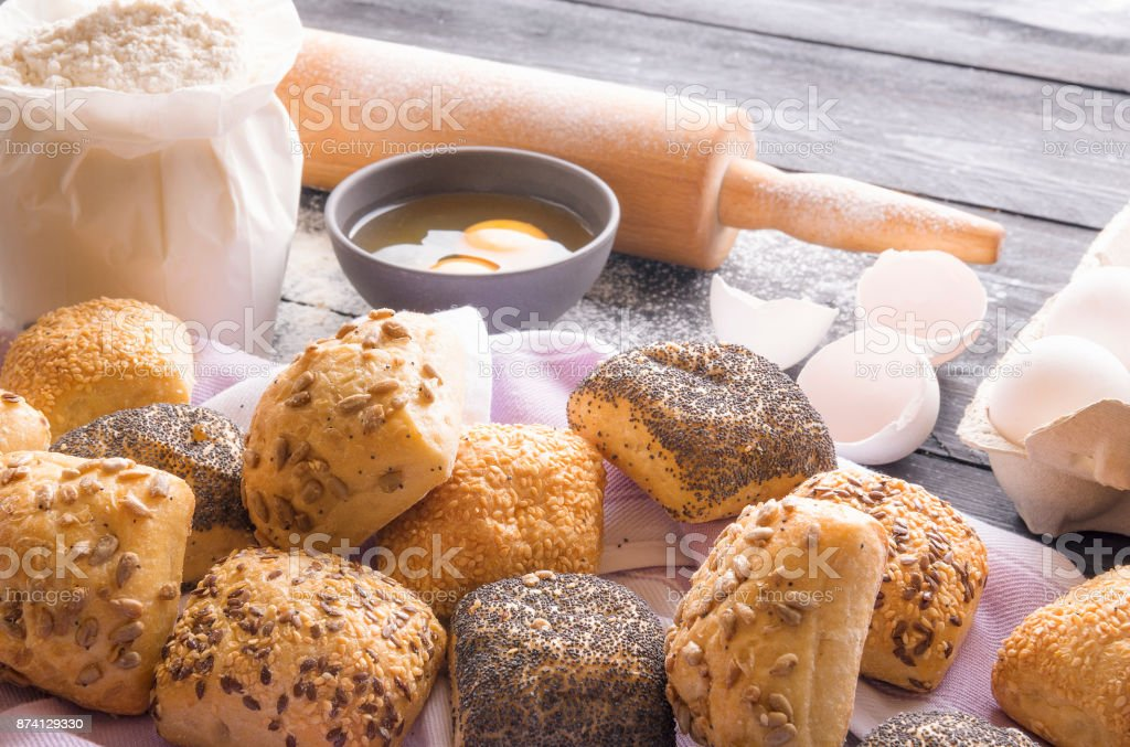 Freshly baked bread rolls and ingredients stock photo