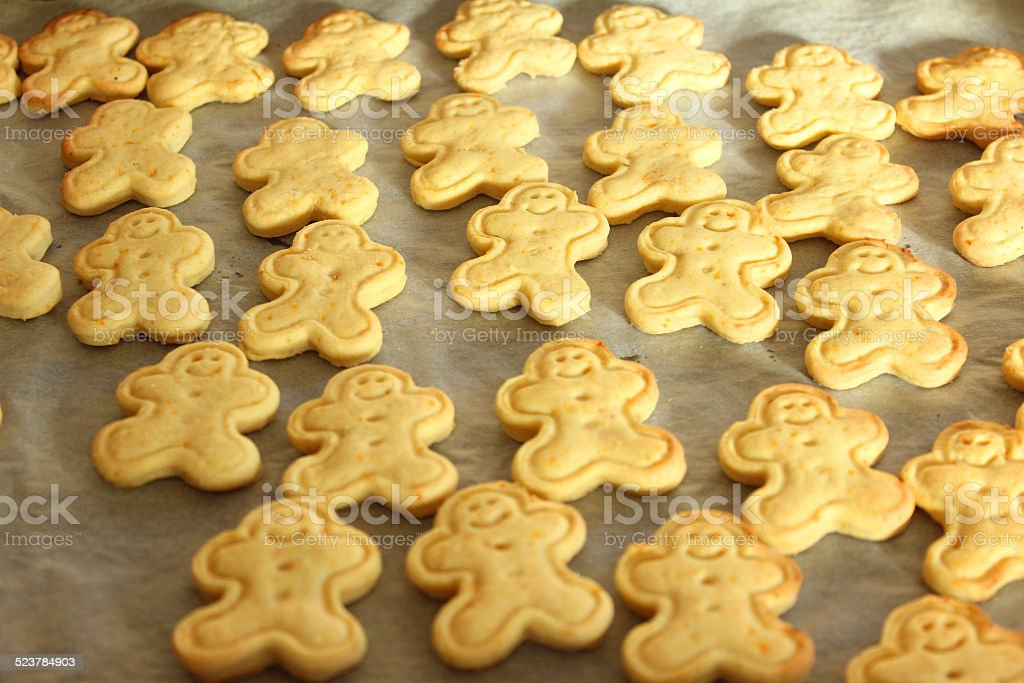 Freshly baked carrot and ginger gingerbread men biscuits / cookie-cutters, moulded stock photo