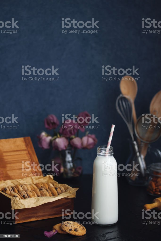 Freshly baked chocolate almond chip cookies and bottle with milk - Royalty-free Almond Stock Photo