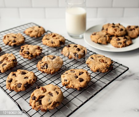 Freshly baked chocolate chip cookies and milk on white marble counter. in Kingston, ON, Canada