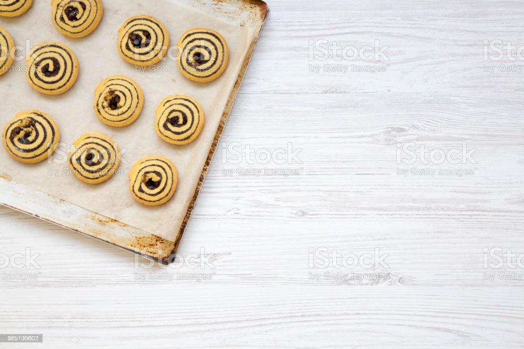 Freshly baked cookies on a baking sheet, top view. Copy space. zbiór zdjęć royalty-free
