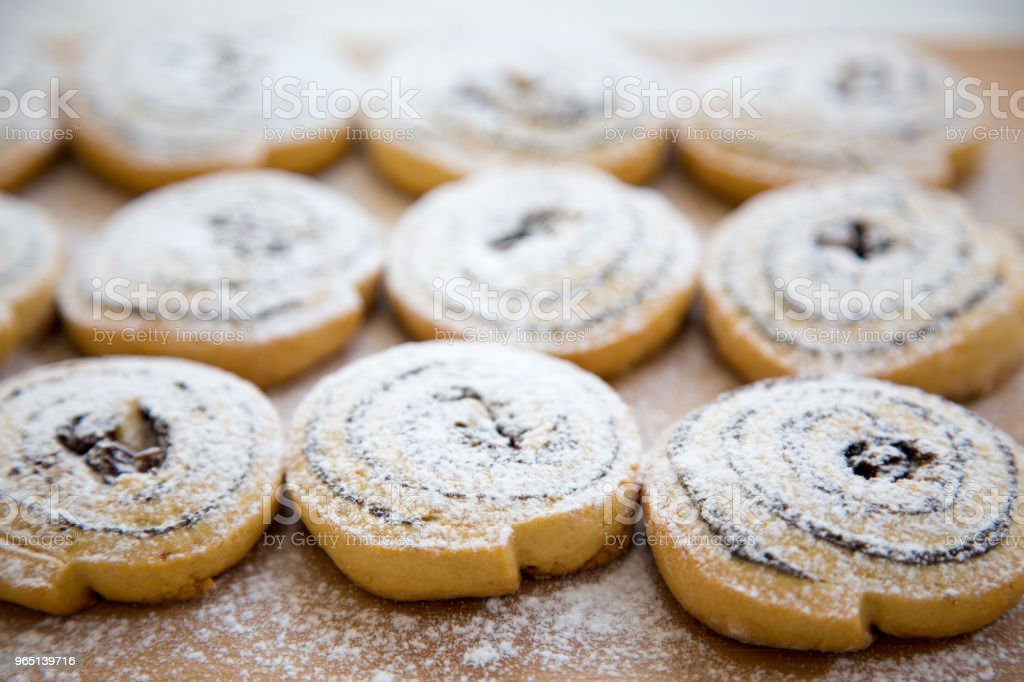Freshly baked cookies on a bamboo board, side view. Closeup. royalty-free stock photo