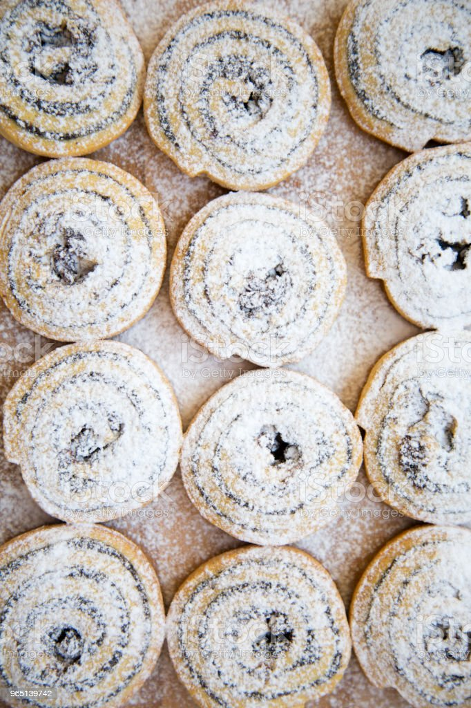 Freshly baked cookies with poppy seeds and raisins on a bamboo board. royalty-free stock photo