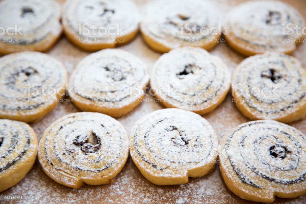 Freshly baked cookies with raisins and poppy seeds on a bamboo board. zbiór zdjęć royalty-free
