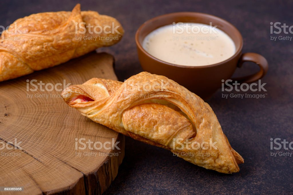 Freshly baked croissants and coffee cup stock photo