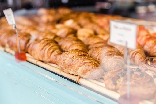 Freshly baked croissants in bakery