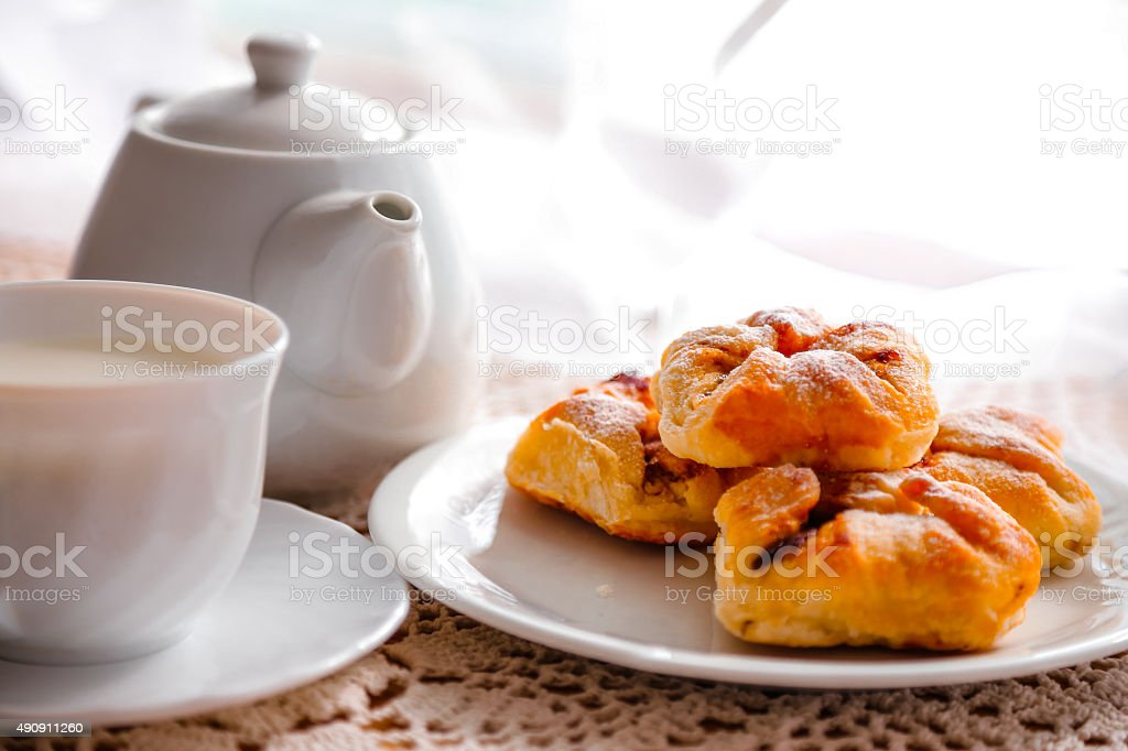 Freshly baked Danish pastries on white plate and hot drink stock photo