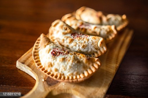 Close-up view of freshly baked empanadas on a plate.