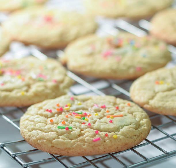Freshly Baked Funfetti Sugar Cookies On Rack, Delicious Homemade Cookies with Sprinkles Soft and delicious freshly baked sugar cookies out from the oven and cooling on a wire rack. sugar cookie stock pictures, royalty-free photos & images