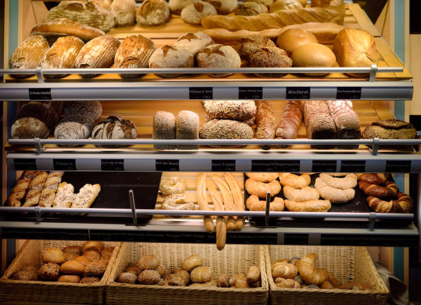freshly baked gourmet breads for sale in german bakery - panetteria foto e immagini stock