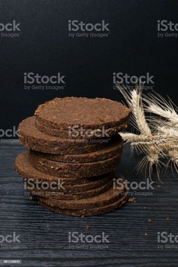 Freshly baked homemade artisan sourdough ry. Rye round sliced gallets. Top view. Close up. Copy space. stock photo