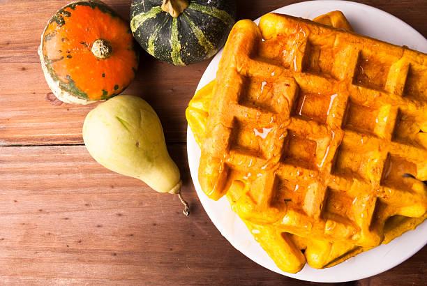 freshly baked homemade belgian waffles with pumpkin - zimt waffeln stock-fotos und bilder