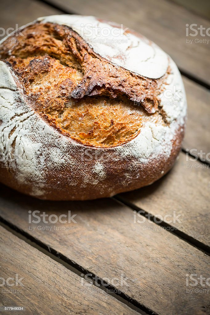 freshly baked homemade rye bread on wooden background zbiór zdjęć royalty-free