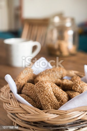 freshly baked homemade sesame biscuits in wicker basket