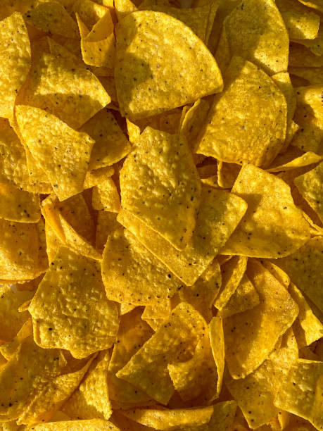freshly baked homemade tortilla chips drying in the natural sunlight stock photo