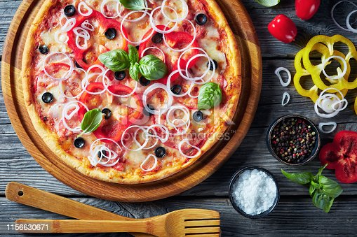 1136817041 istock photo Freshly baked italian pizza with tomatoes, cheese, onions and bell pepper 1156630671