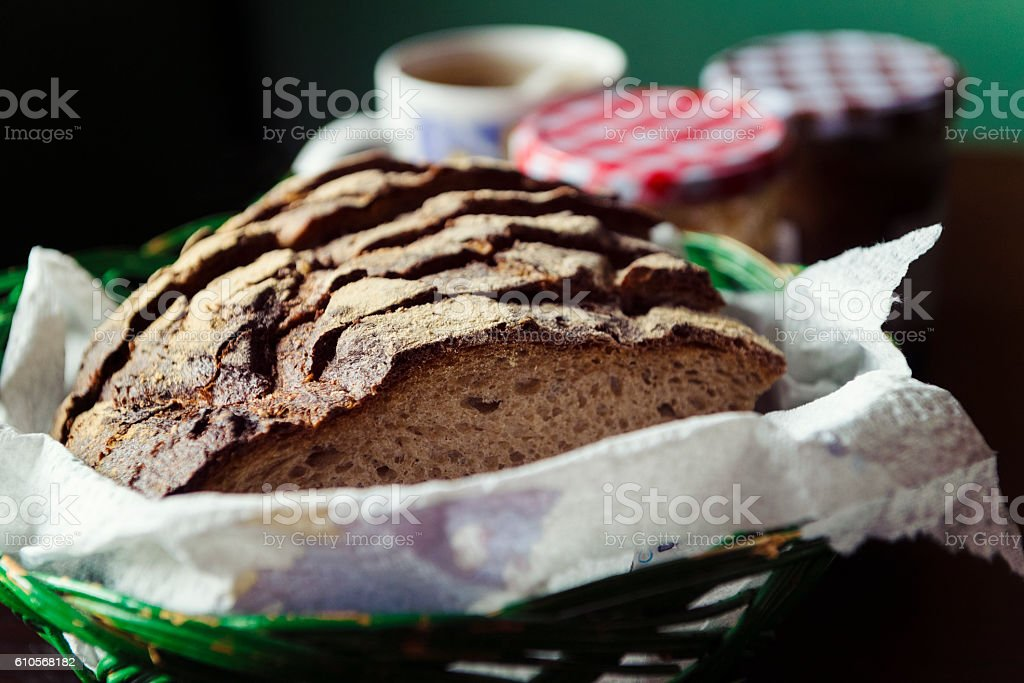Freshly Baked Loaf of Whole-Grain Bread in a Swiss Cottage stock photo