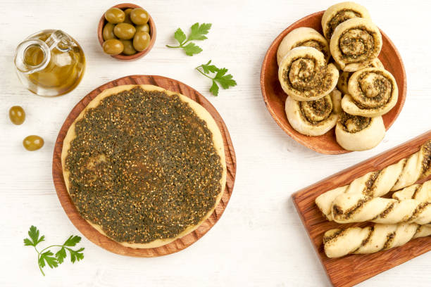Freshly baked   manakeesh, swirls and straws with zaatar . Top view with copy space Food, Arabic cuisine, Zaatar, Breakfast zaatar spice stock pictures, royalty-free photos & images