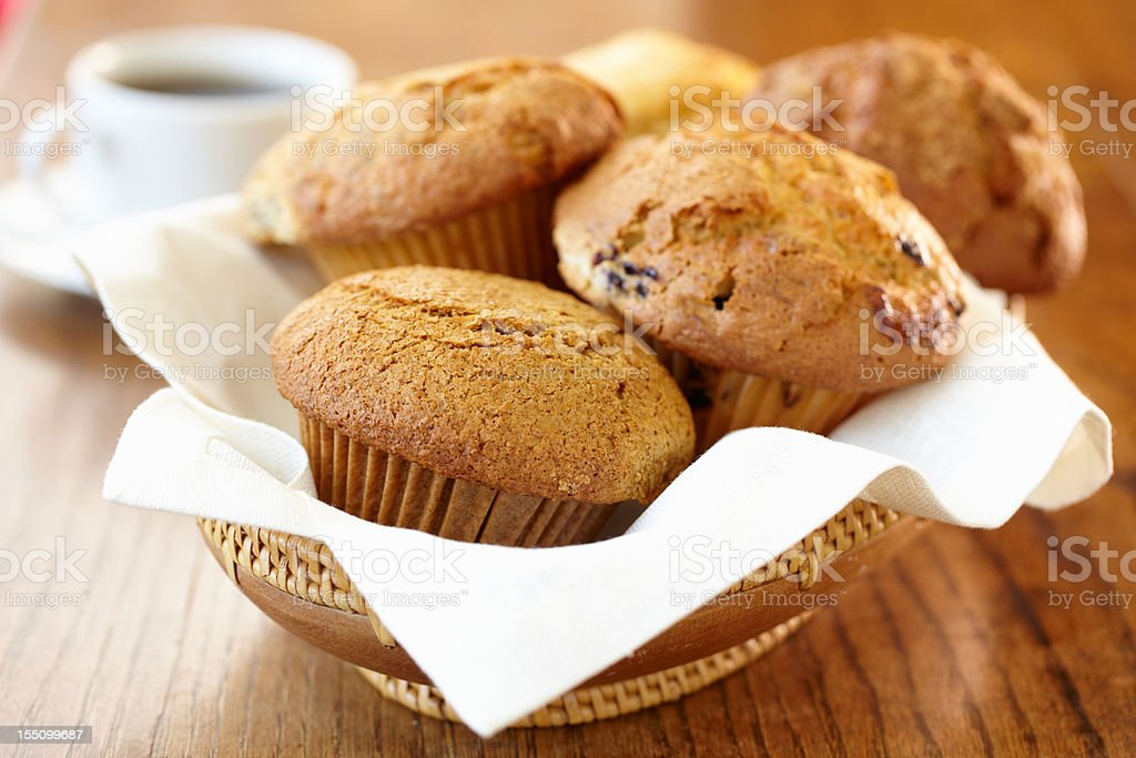Freshly baked muffins on a wooden bowl stock photo