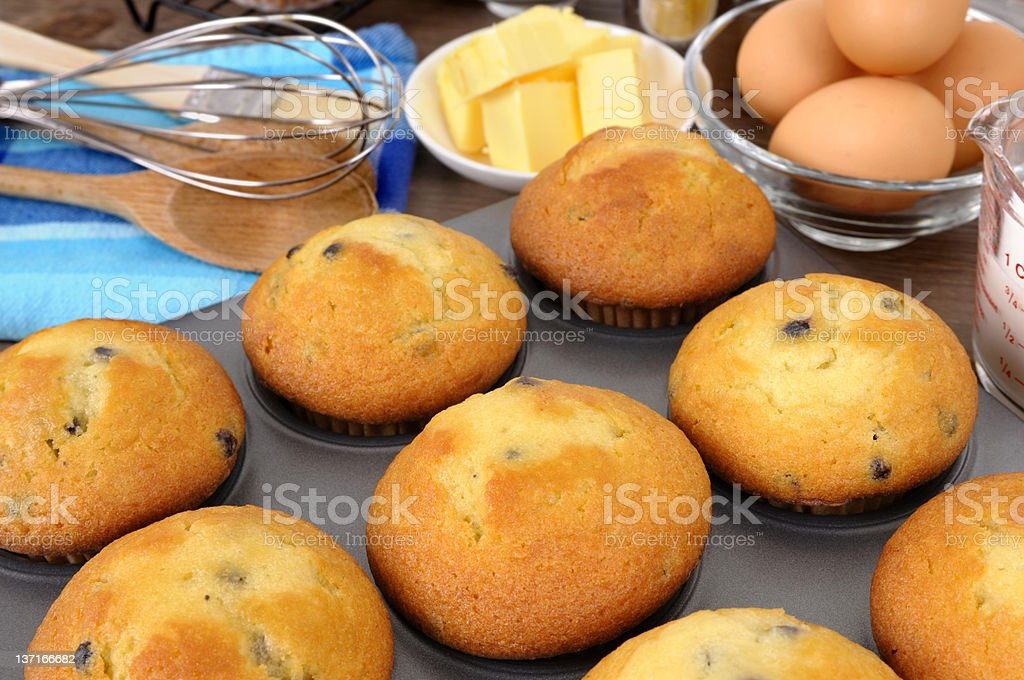 Freshly baked muffins with ingredients royalty-free stock photo