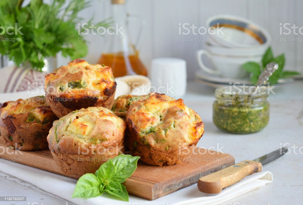 Freshly baked muffins with spinach, sweet potatoes and feta cheese on white background. Healthy food concept. Savory pastry. stock photo