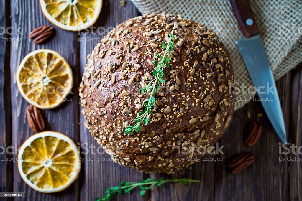 freshly baked multigrain bread on rustic background stock photo