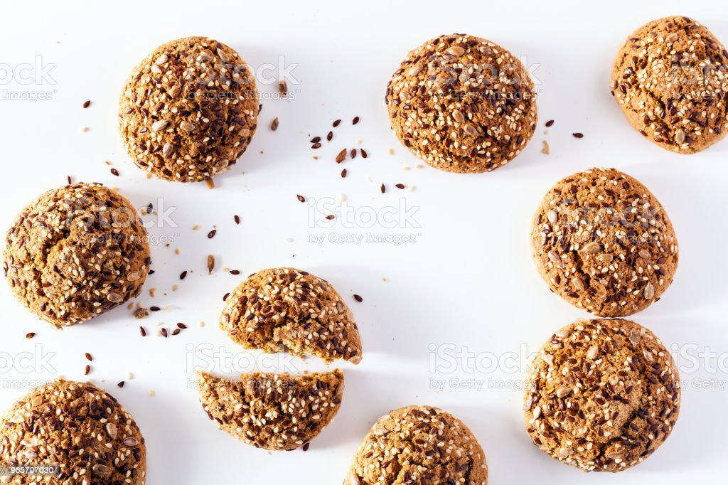 freshly baked oatmeal cookies sprinkled with sunflower seeds, li - Royalty-free Backgrounds Stock Photo