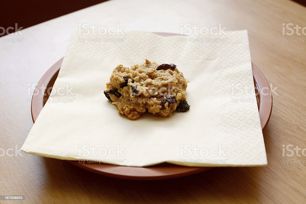 Freshly baked oatmeal raisin cookie stock photo