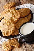 istock Freshly baked peanut butter cookies with a cup of milk close-up. vertical 1194502751