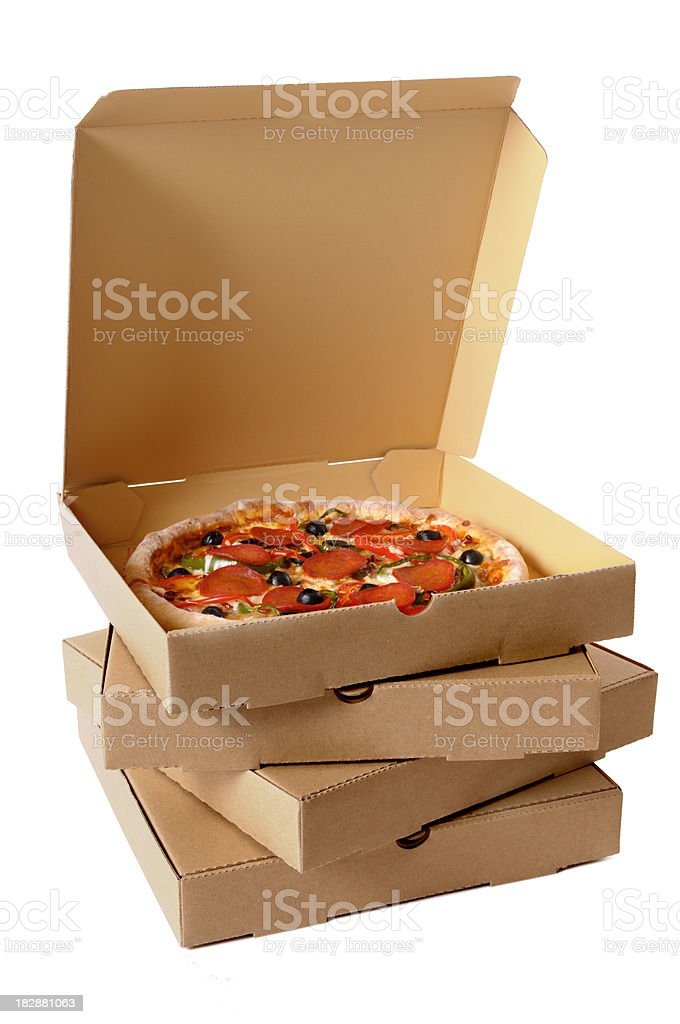 Freshly baked Pizza with stack of delivery boxes stock photo
