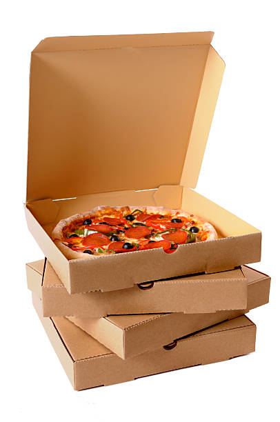Freshly baked Pizza with stack of delivery boxes Freshly baked Pizza with a stack of delivery boxes (focus is on the front of the boxes).  Alternative version shown below: medium group of objects stock pictures, royalty-free photos & images