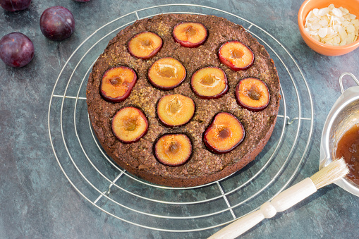 Freshly Baked Plum Cake on Cooling Rack