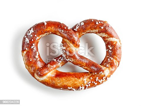 freshly baked pretzel isolated on white background, top view