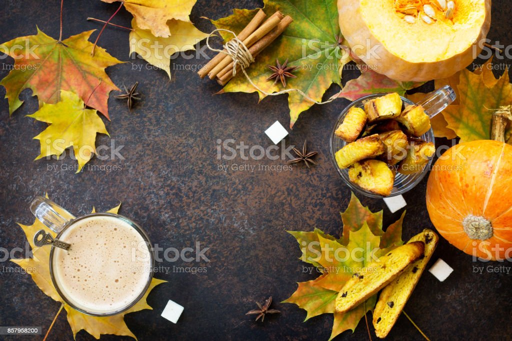 Freshly baked raisins and cinnamon biscotti and a cup of cappuccino coffee on a brown slate or slate background. Top view with copy space. stock photo