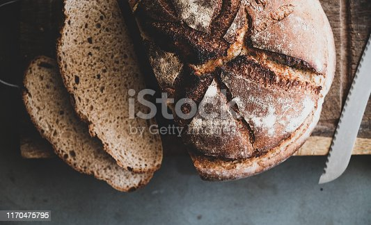 istock Freshly baked sourdough bread loaf and slices, close-up 1170475795