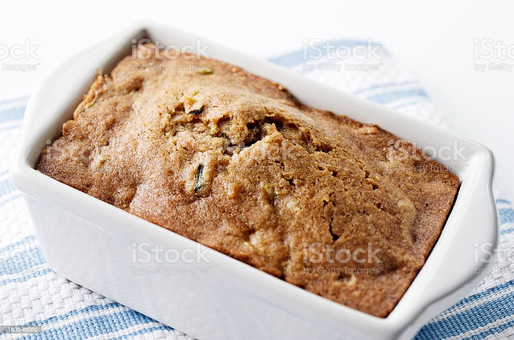 Freshly baked zucchini bread in a white container royalty-free stock photo