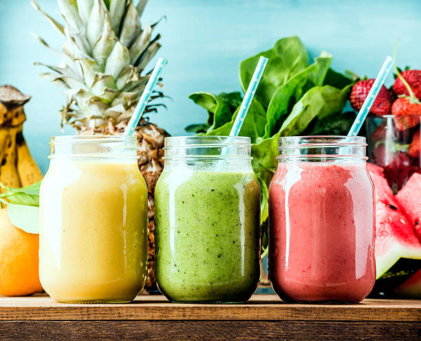 freshly blended fruit smoothies of various colors and tastes - food and drink stock photos and pictures