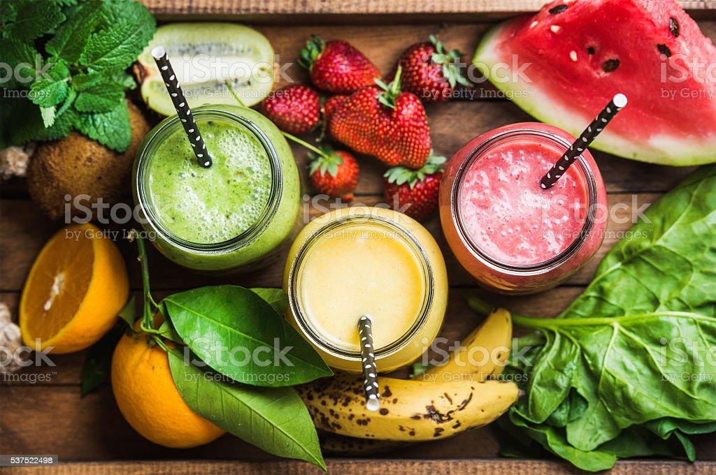 Freshly blended fruit smoothies of various colors and tastes stock photo