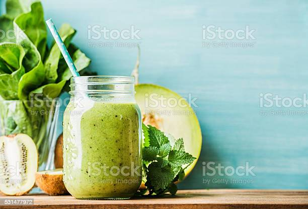 Freshly blended green fruit smoothie in glass jar with straw picture id531477972?b=1&k=6&m=531477972&s=612x612&h=kutlv7inifwxkmdy7ymoe3yjpwh8uf956tfzmz9hjva=