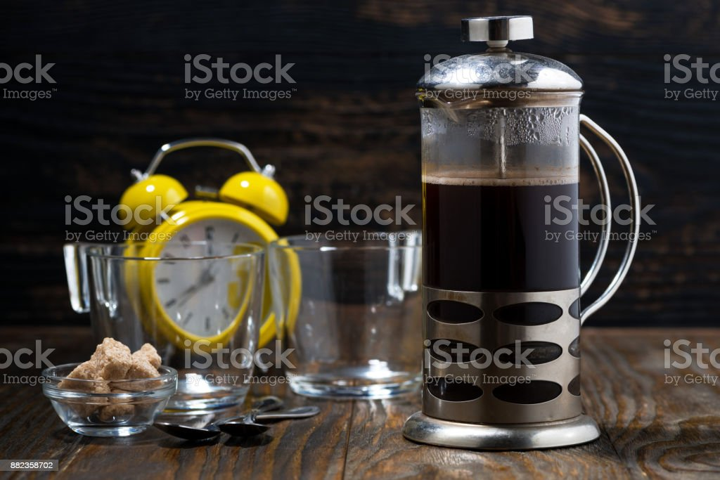 freshly brewed coffee in the french press for breakfast, closeup...